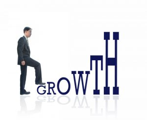 Growth - businessman with growth word