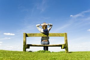 Women - woman thinking on bench in field